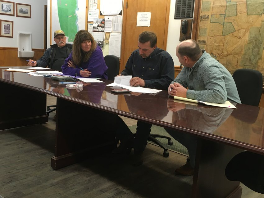 Zoning officer Ed Lagarenne, left, secretary Melissa Haviland, chairman Joseph Canfield, operational supervisor Steven Adams and, not pictured but connected to the meeting via telephone, vice-chairman Daniel Rutledge attend the Damascus Township meeting.