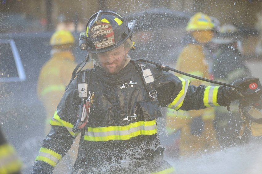 G. Bradley of the White Sulphur Springs VFD was among the firefighters who were hosed down after the fire.