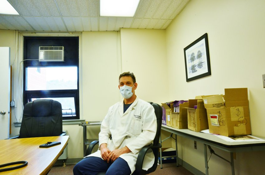 Dr. Sean McVeigh finds little pockets of time throughout the day for sleeping and eating; most of the time he's busy heading up WMH's COVID-19 isolation unit.