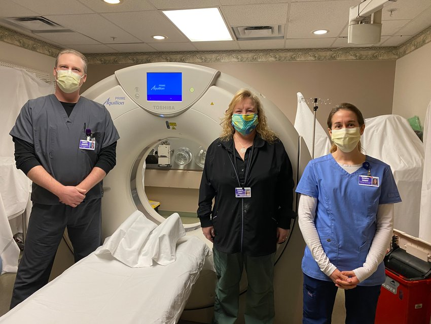 Wayne Memorial CT scan technologists Doug Buchinski, left, and Michelle Murray, far right, along with MRI technologist Beth Carney, center, say they're ready to see more patients.
