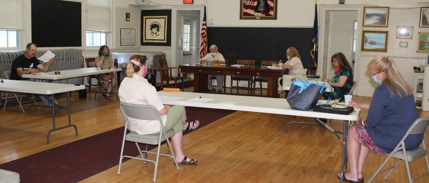 Lumberland's town board maintained social distancing during its first face-to-face meeting in months. Pictured are Jim Akt, left, Karen Warden, Zoriana Gingold, Leigh Sherman, Jenny Mellan, Laurie Terry, Town Clerk and Danielle Jose-Decker, Town Counsel.