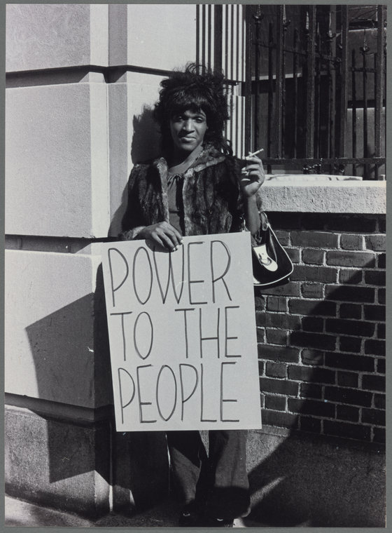 Marsha P. Johnson pickets Bellevue Hospital to protest the treatment of LGBTQ and those living on the street.