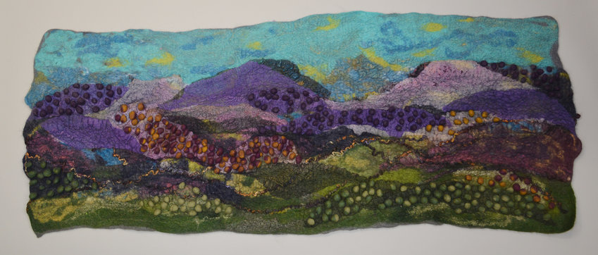A wall hanging by Ellen Silberlicht portrays the Smoky Mountains, made of dyed sheep's wool that has been felted.
