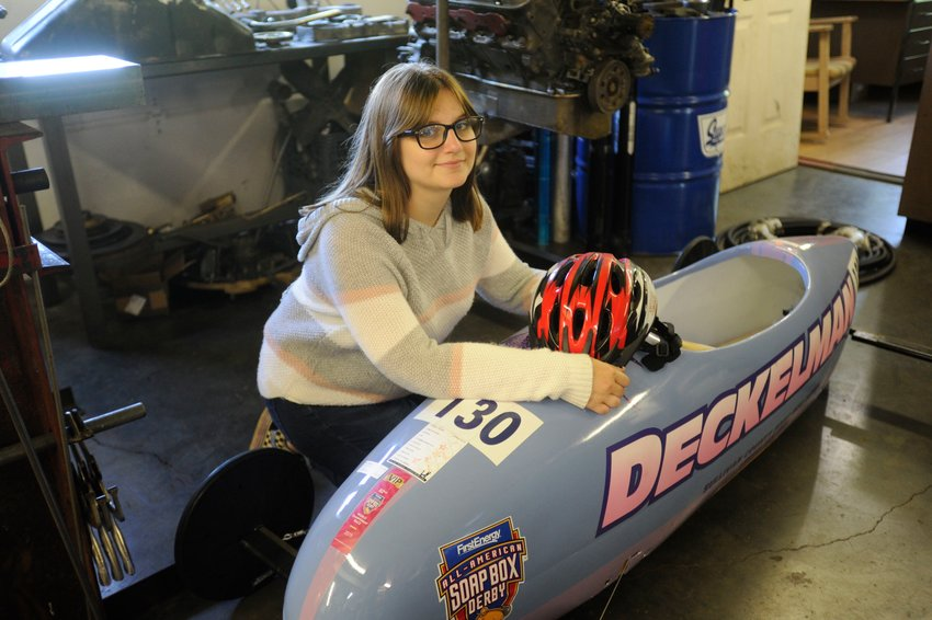 Past glories. Monika Deckelman poses in her dad's machine shop with her Soap Box Derby racer. Last year, she finished 10th in her division at the Soap Box Derby Nationals in Akron, OH.