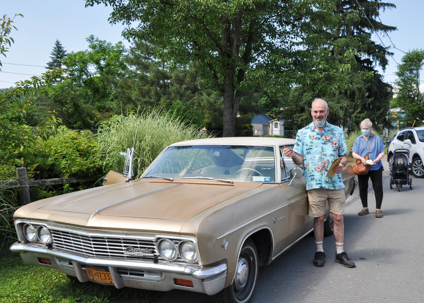 "Craig Smith, Susan Miiler and Dharma the Wonder Dog (way in the back) all posed with Smith's '66 Chevrolet Impala Sport Coupe at the Artists' Market Community Center's ""Fourth of July Celebration of Vintage Vehicles"" last Saturday in Shohola, PA."