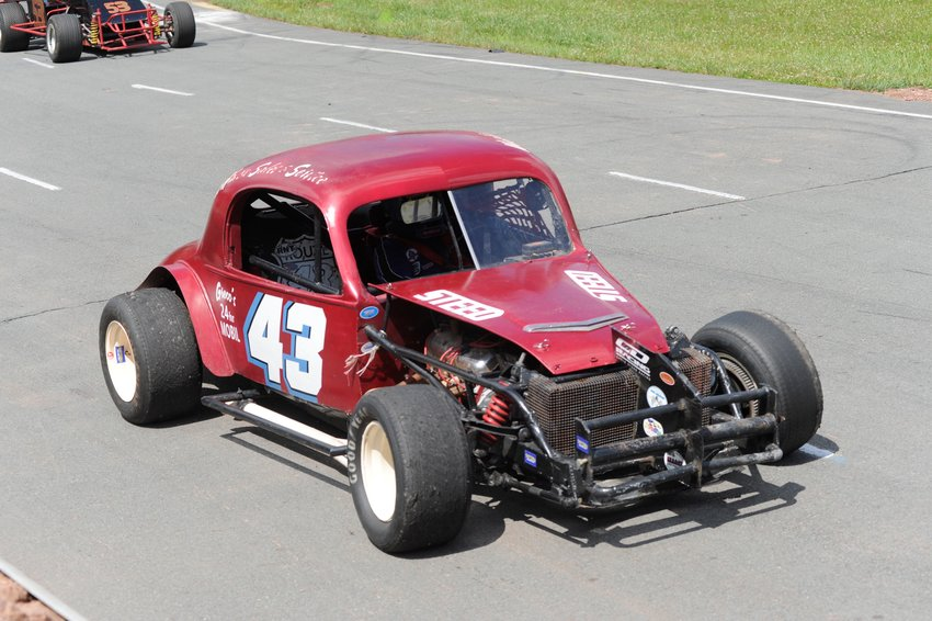 Richard Belmonte of Meriden, CT is pictured at speed on Bethel Motor Speedway's quarter-mile oval.