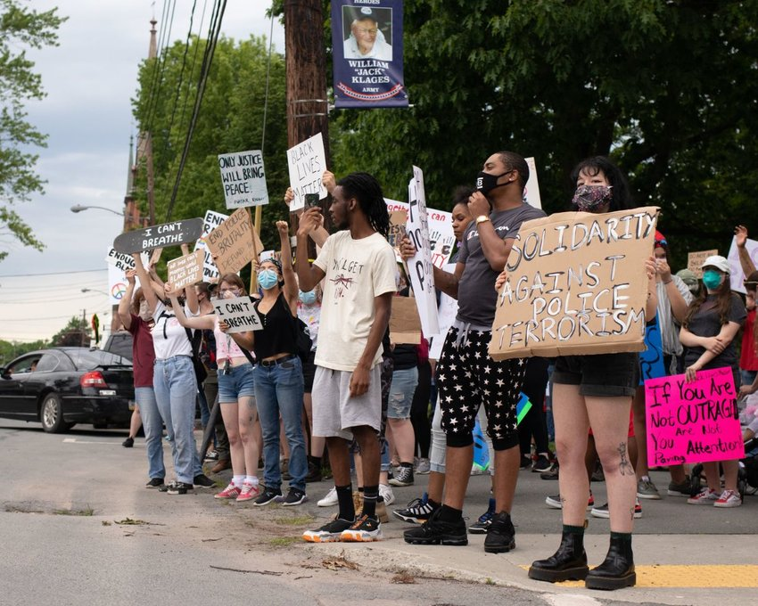 A group of protestors stands at the edge of the Honesdale Central Park along Church Street in solidarity with the Black Lives Matter movement Thursday, June 4.