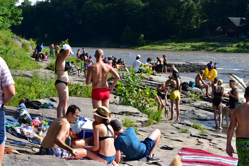 The summer scene at Skinner's Falls is always hopping. Flat rocks jut into the river, making it a great place to gather.
