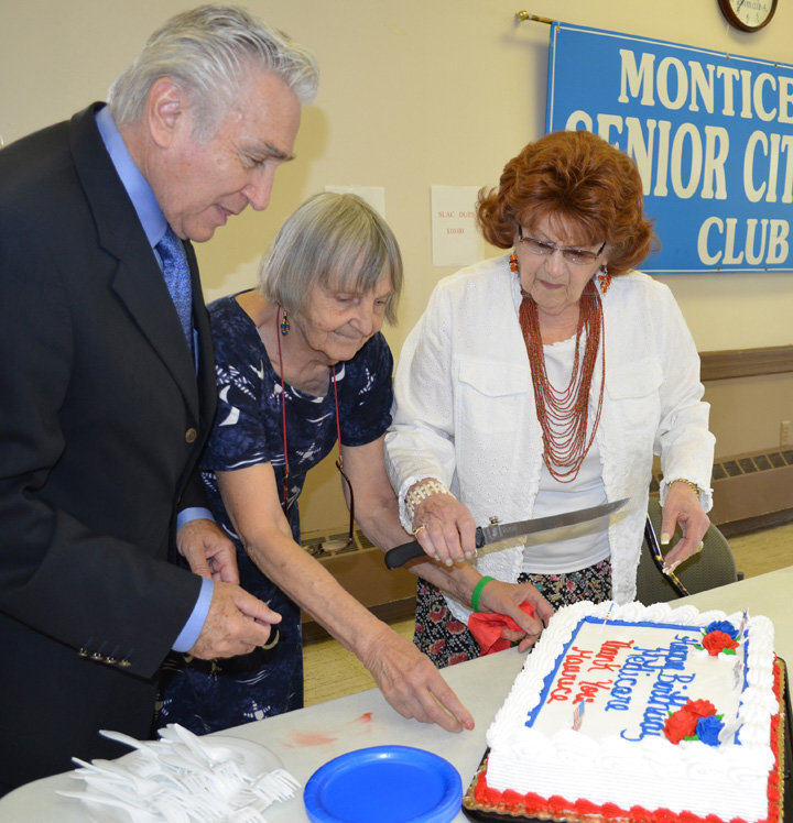 Former Congressman Maurice Hinchey, left, prepares to cut a Medicare birthday cake with the co-chairs of the Sullivan County Senior Legislative Action Committee (SLAC), Priscilla Bassett and Roz Sharoff, at a SLAC meeting in 2009.