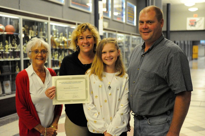 """Maggie Herbert, not pictured, a Sullivan West graduate of the Class of 2020, was recognized for her """"outstanding academic performance"""" at the Sullivan West Board of Education meeting on August 27. As she is attending SUNY Morrisville, her family accepted the certificate on her behalf: grandmother Kathy Herbert, left, mother Katie Herbert, sister Ella Herbert and father Joe Herbert."""
