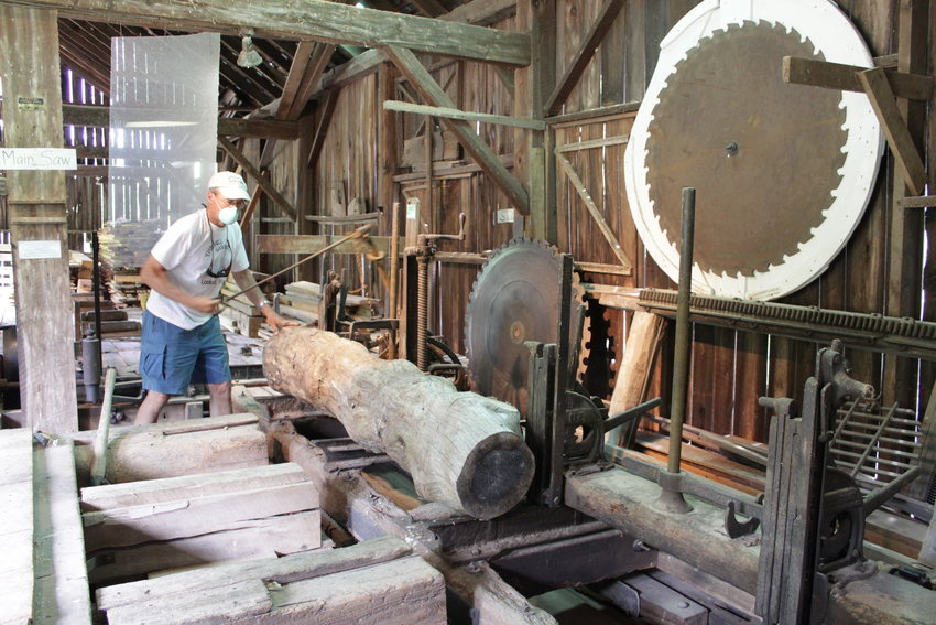 Greg Quaglio, from the Equinunk Historical Society, demonstrates the mill's operations.