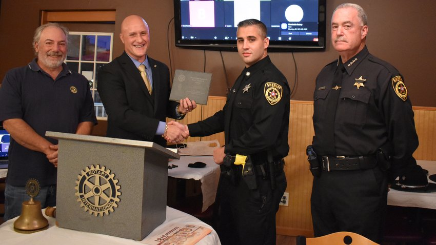 Sponsor of this Month's Monticello Rotary's T.A.C.T.I.C.A.L. Award plaque and dinners, Rotarian   Carmine Ribaudo, left, president Todd Grodin, deputy Markus V. Pratti, and sheriff Mike Schiff.
