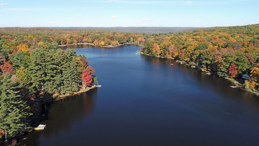 This is Walker Lake in Shohola, PA taken on October 14. There are various types of forest here, and the maples are bright red and yellow. Some of the oaks are dark yellow and some are still green.