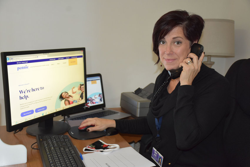 Laura Resti of Wayne Memorial Community Health Centers' Outreach and Enrollment office is shown previewing  www.pennie.com, the State of Pennsylvania's healthcare insurance marketplace. The website is open to the public as of November 1.
