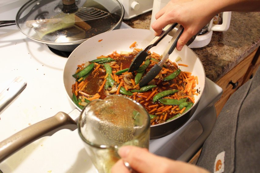 As the soy sauce is added, stir lightly to incorporate the building flavors.