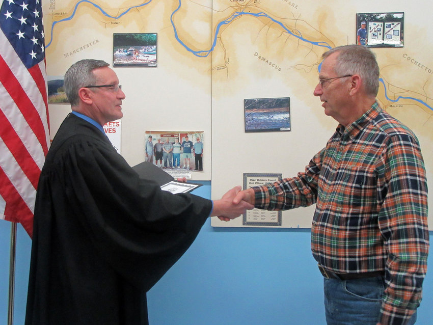 Newly-elected Upper Delaware Council Chairperson Jeffrey R. Dexter, right, of Damascus Township is shown being sworn in last year by the Hon. Steven Sauer, Town Justice for the Town of Cochecton, at the Feb. 6, 2020 UDC meeting.