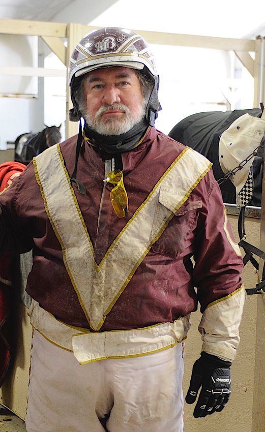 Veteran horseman Murray Bassen strikes a pose in the Monticello Raceway paddock in early January 2021.