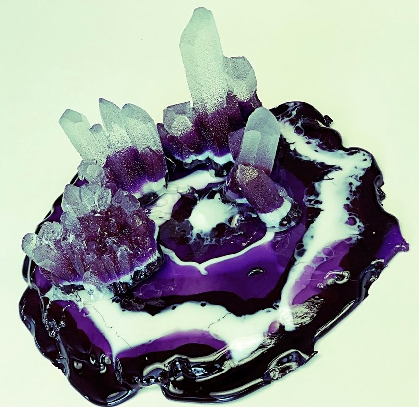 "According to Mycrystals.com, ""The eye-catching amethyst crystals have a long history of meanings and properties, all of which are positive, as they were known to bring forth the purest aspirations of human kind."
