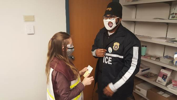 Tiffany Kahn, RN, gives Fallsburg Police Chief Simmie Williams the #SullivanSafe sticker after getting the COVID-19 vaccine. He was one of Sullivan County's 150 local first-responders who were vacinnated on January 21.