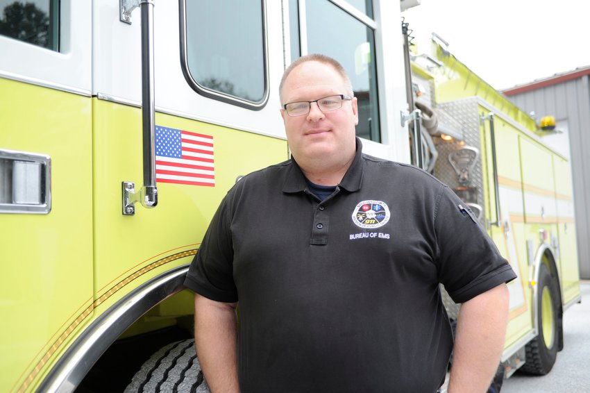 "Alex Rau, Sullivan County E-911 and EMS coordinator, joined the Liberty Volunteer Ambulance Corps at the age of 16. ""We have a great team of public safety people,"" said Rau of the 911 Center that serves more than 70 agencies."