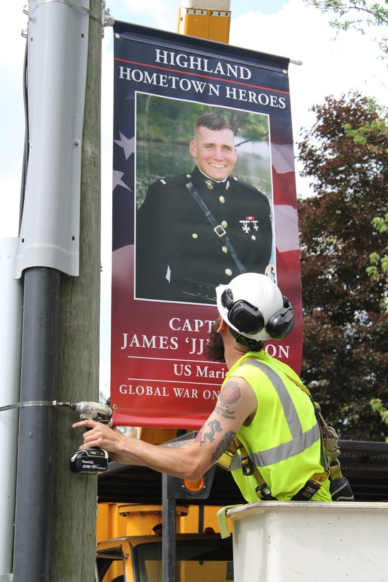 George Speer puts the finishing touches on Captain Hanson's banner