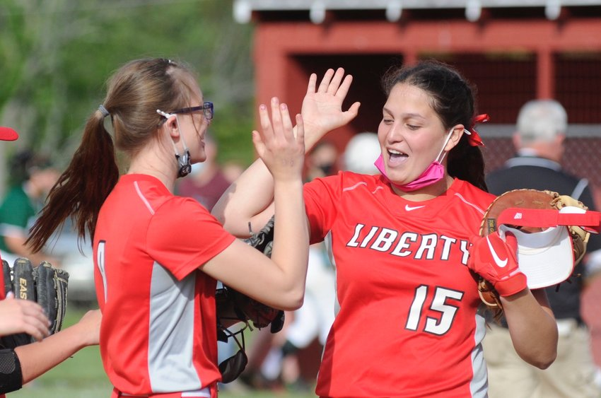 High fives. Liberty's winning pitcher Rebecca Philips, left, is congratulated by first baseman Yanire Wilson after the upset victory.
