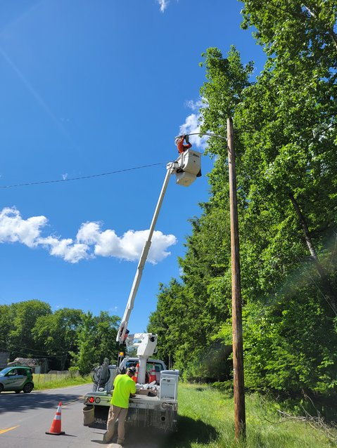 Installing the LED lights in the Town of Bethel.