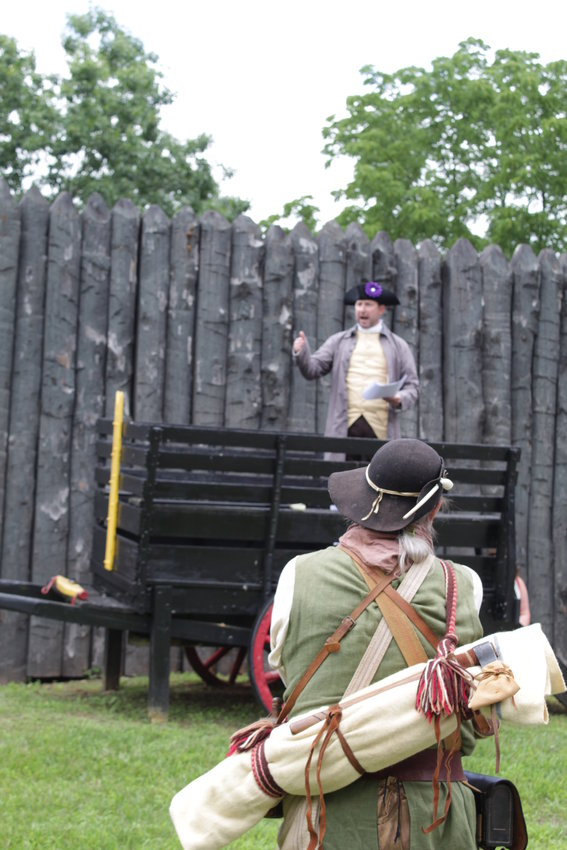 """""""You are long-winded. I have a long barrel."""" Re-enactor and Patriot Charles Redner (back to camera) comments while Bill Chellis reads a Loyalist response."""