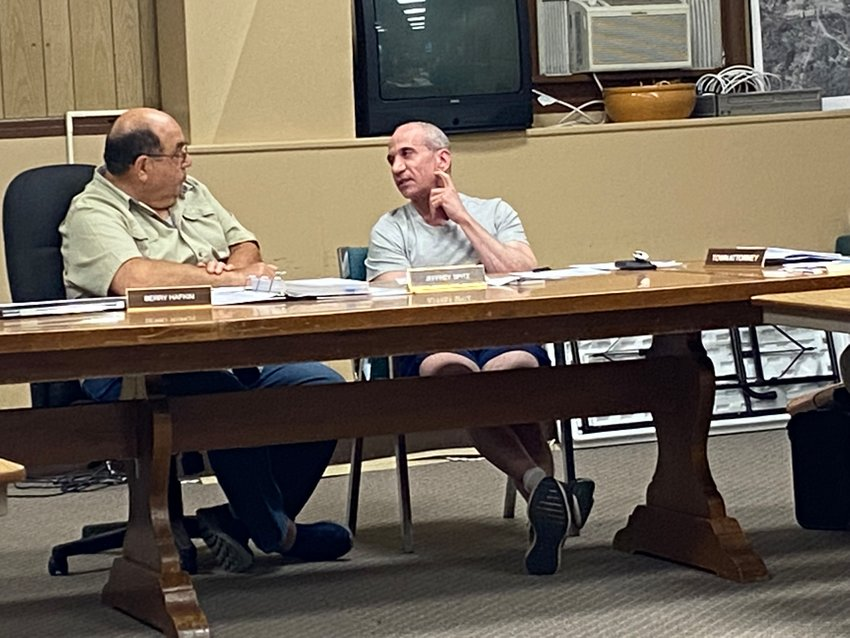 Highland Planning Board Chairman Berry Hafkin, left, speaks to Jeff Spitz as they work out conditional language that could be added to a special use permit to address neighbors' concern.