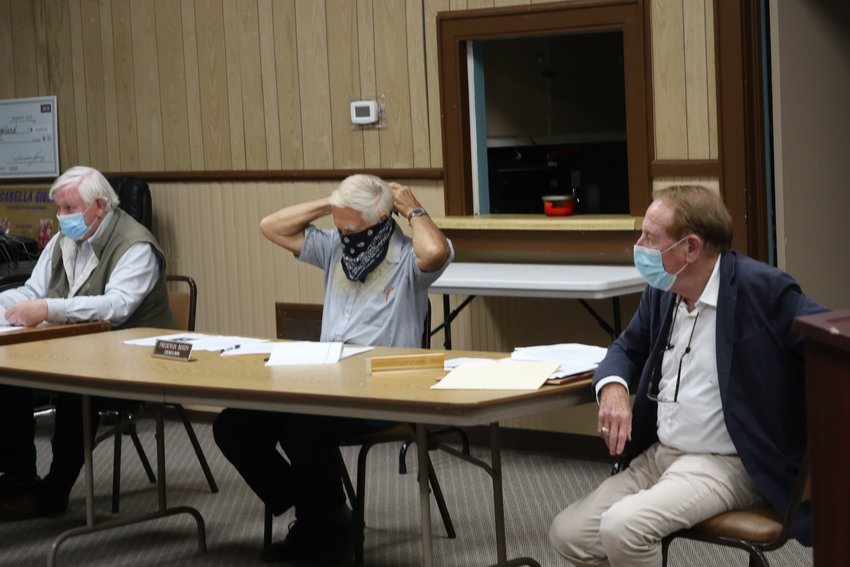 As soon as the Highland Town Board passed the motion to require masks for town employees and highly suggest that people wear masks in town buildings, board members whipped out their masks and put them on.
