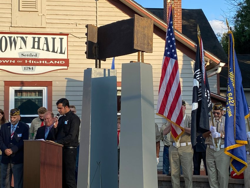 The Town of Highland Town Board organized the ceremony marking the 20th anniversary of September 11, 2001. Boy Scout Troop 102 stands behind the podium...