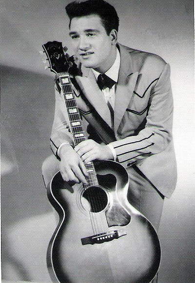 Country music star Mickey Barnett with his guitar.
