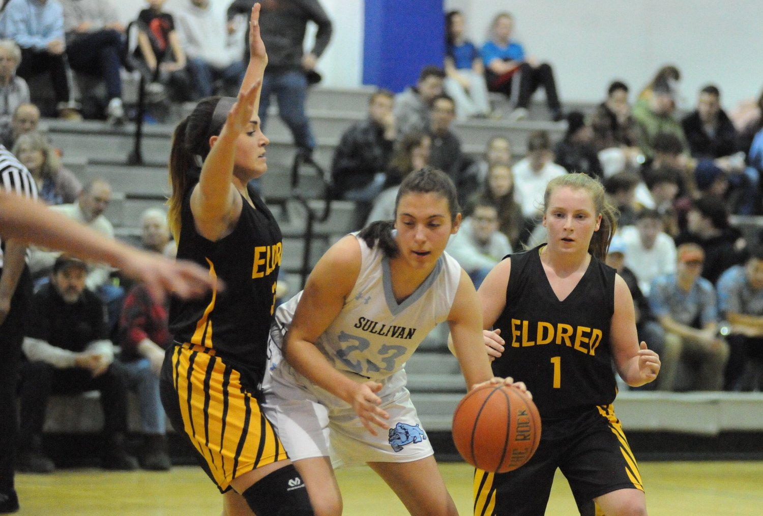 Driving to the paint. Sullivan West's Sabrina Martinez enters the paint zone as Eldred defenders HalieeKolvanbach and LenaeKelty try to make her change her winning ways.
