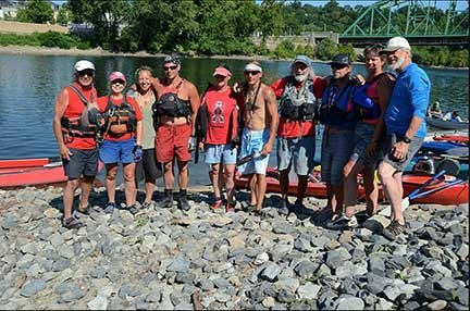 A group of paddlers lines up to pose at one of the many stopping points the Lenape Nation river journey takes on the way from Hancock to the ocean.