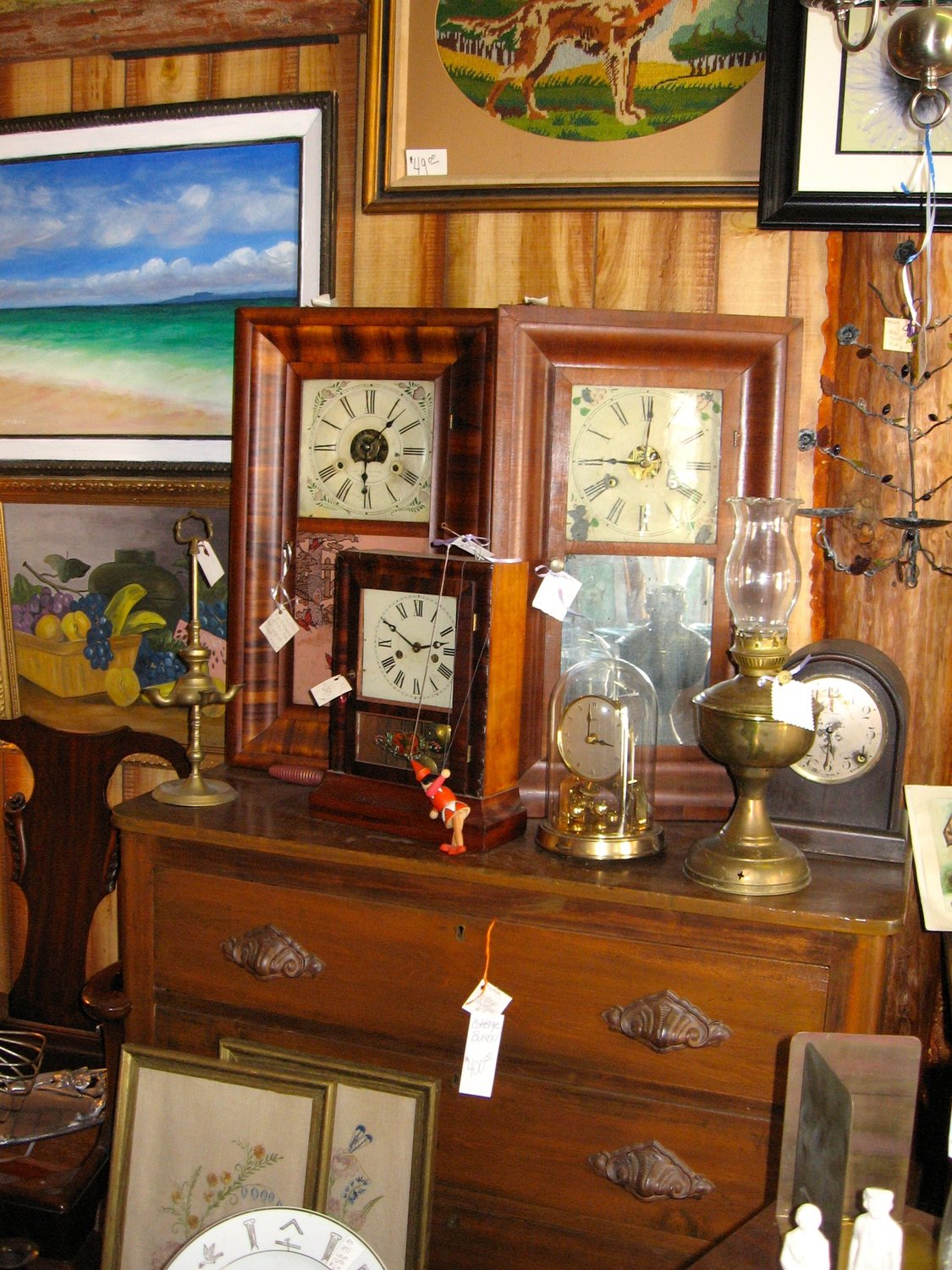 This collection of early 19th century clocks caught the author's eye at Sandspring Antiques and Art in Hawley, PA.