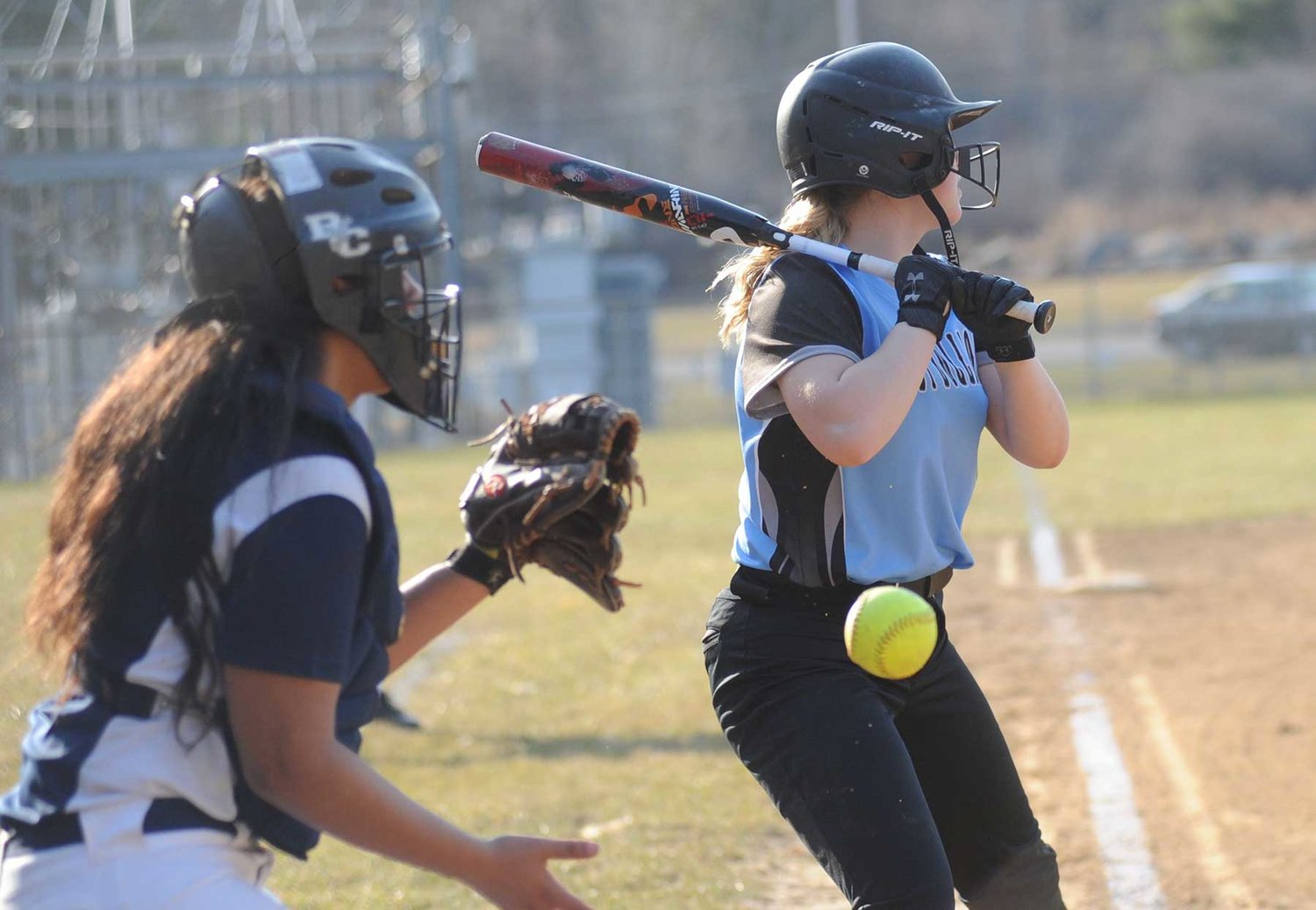 Just lookin! Sullivan West's Morgan Kraack sizes it up and passes on a high pitch.