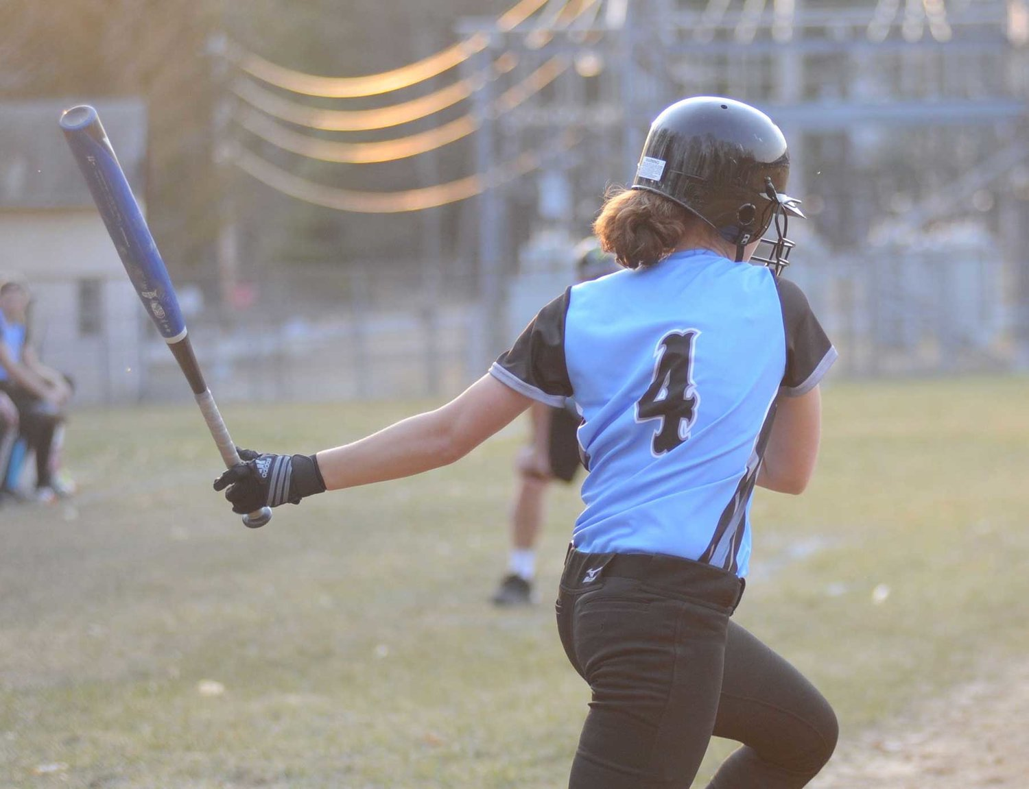 Sullivan West's Kelsy Farrell takes off for first base.