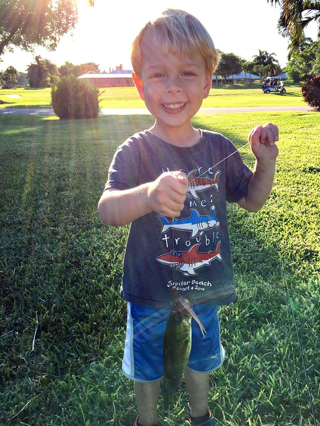 Josh's son Layton poses a few days ago with his first bass.