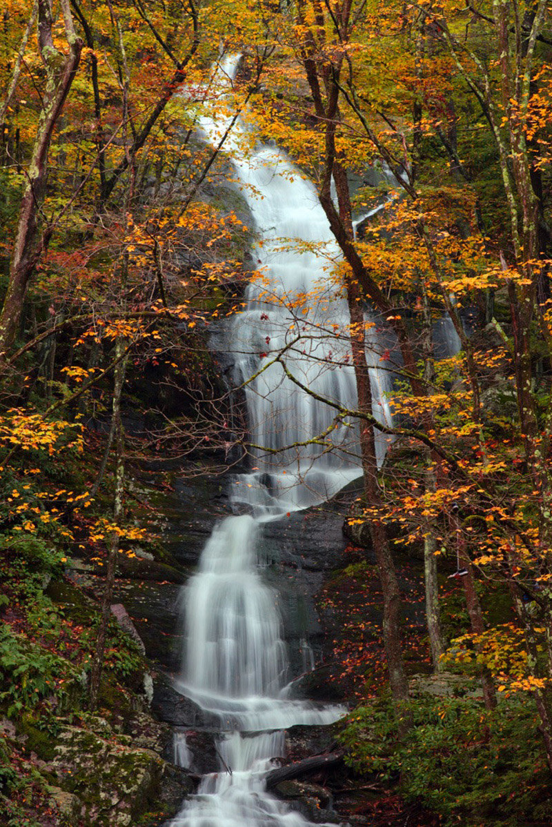 Buttermilk Falls tumbles roughly 200 feet down a series of rock ledges and features wooden stairs and viewing plat-forms.