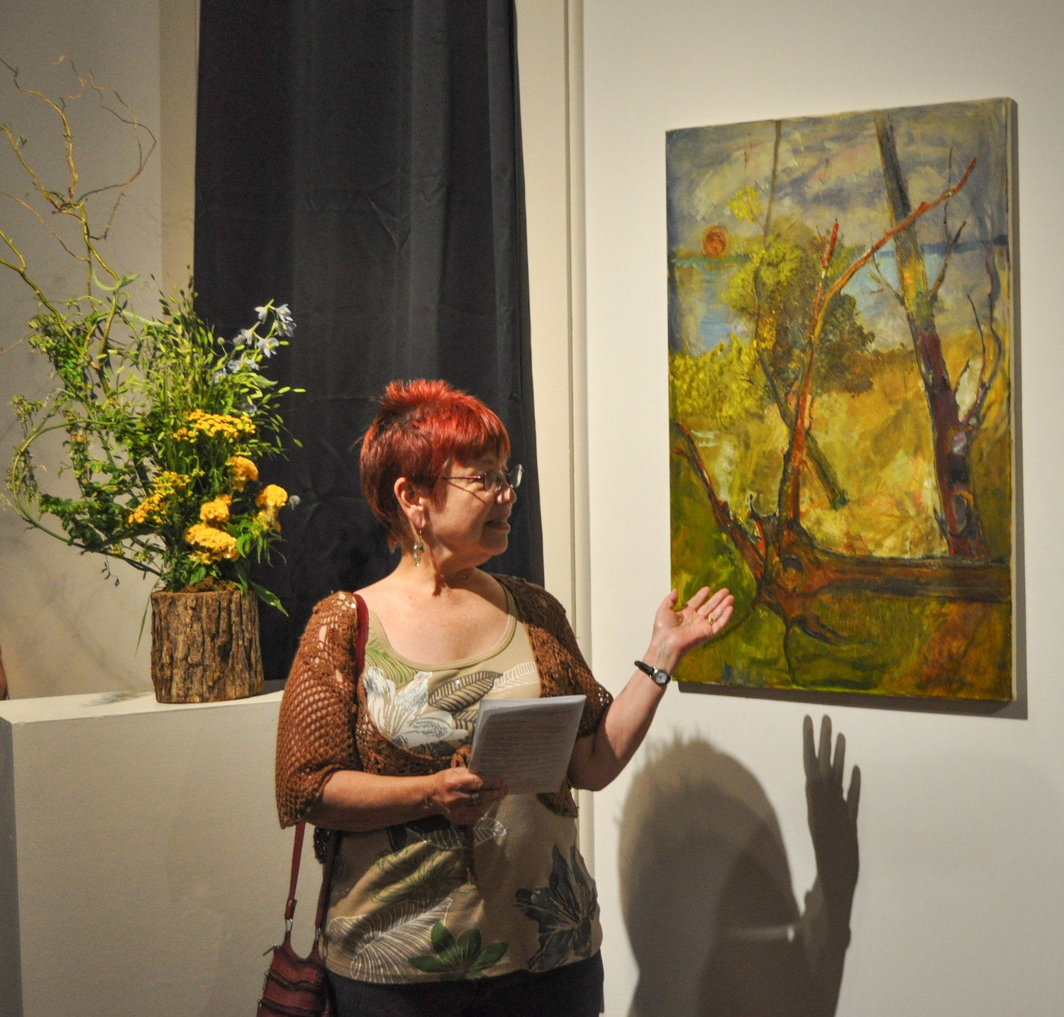 "Nancy Dymond read ""Uprooted,"" written in concert with Jill Weiner's floral design, and John Griffin's acrylic on canvas at the DVAA's annual exhibit, ""Art in Bloom and Verse."""