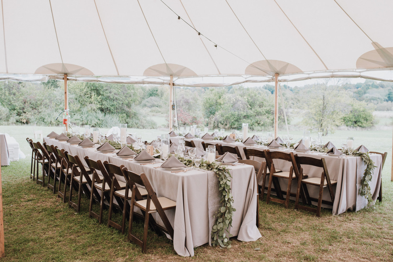 Wedding planner Hilary Smith can help couples set up a backyard wedding with a tent, and she organizes everything from the catering to the tent setup.