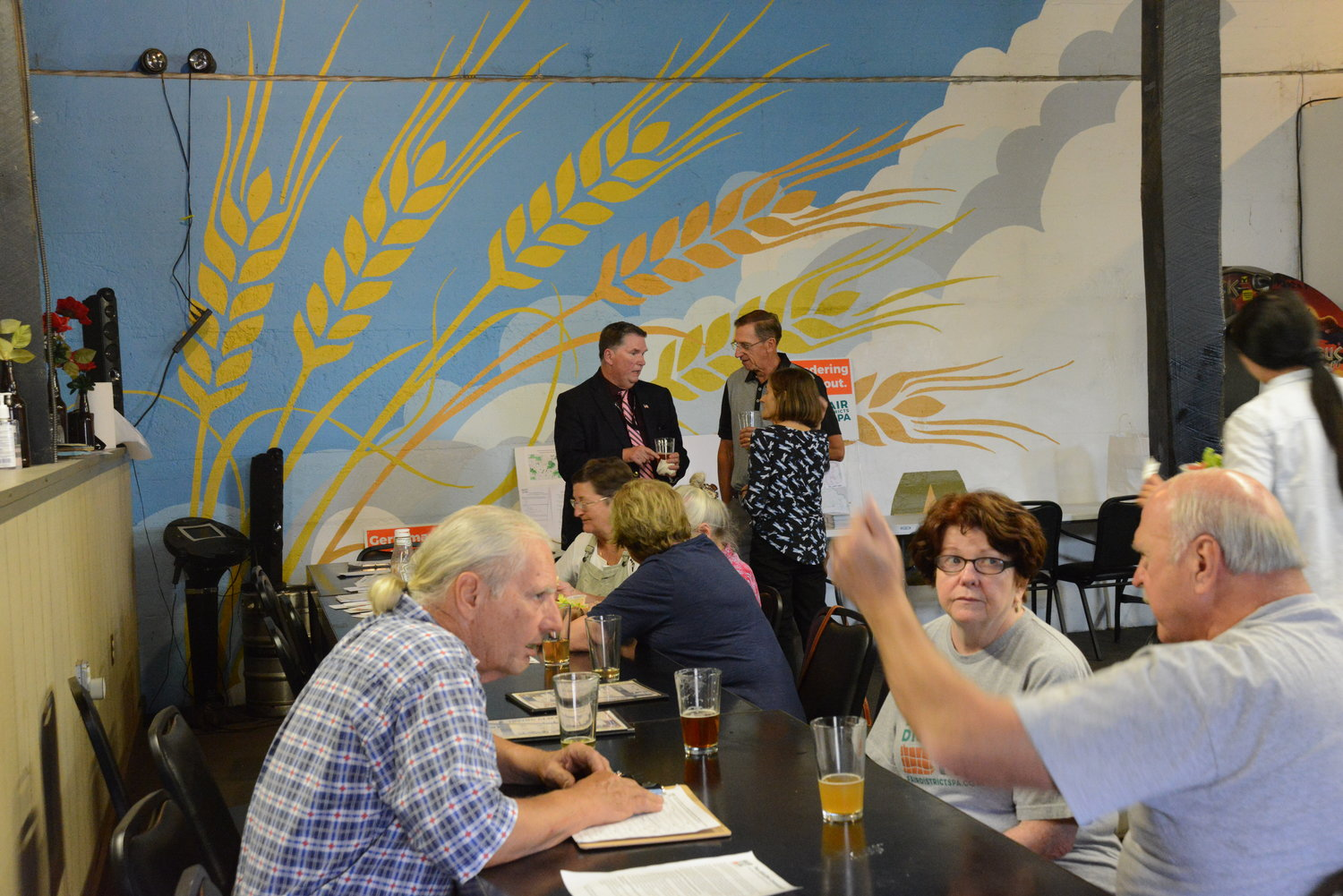 Wayne County residents discuss politics over some beer and food at the Iriving Cliff Brewery.