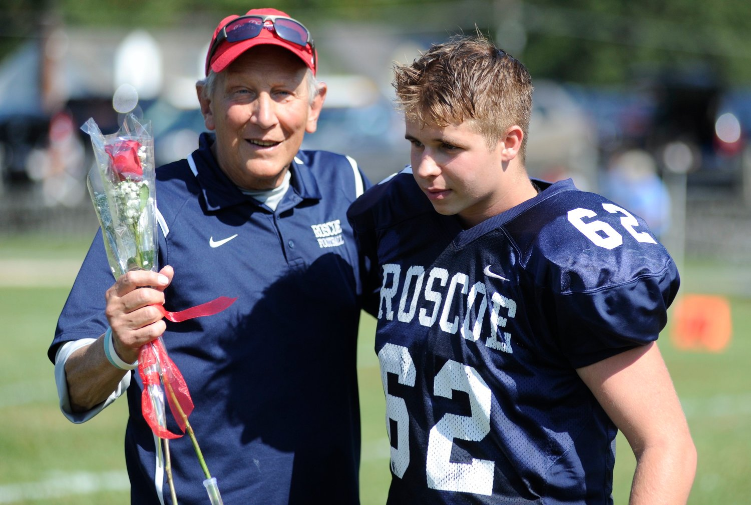 Coach Fred Ahart of Roscoe/Livingston Manor/Downsville, congratulates Jesse Ouimet, one of four seniors on the Blue Devils football team, which is comprised of players from three local schools.