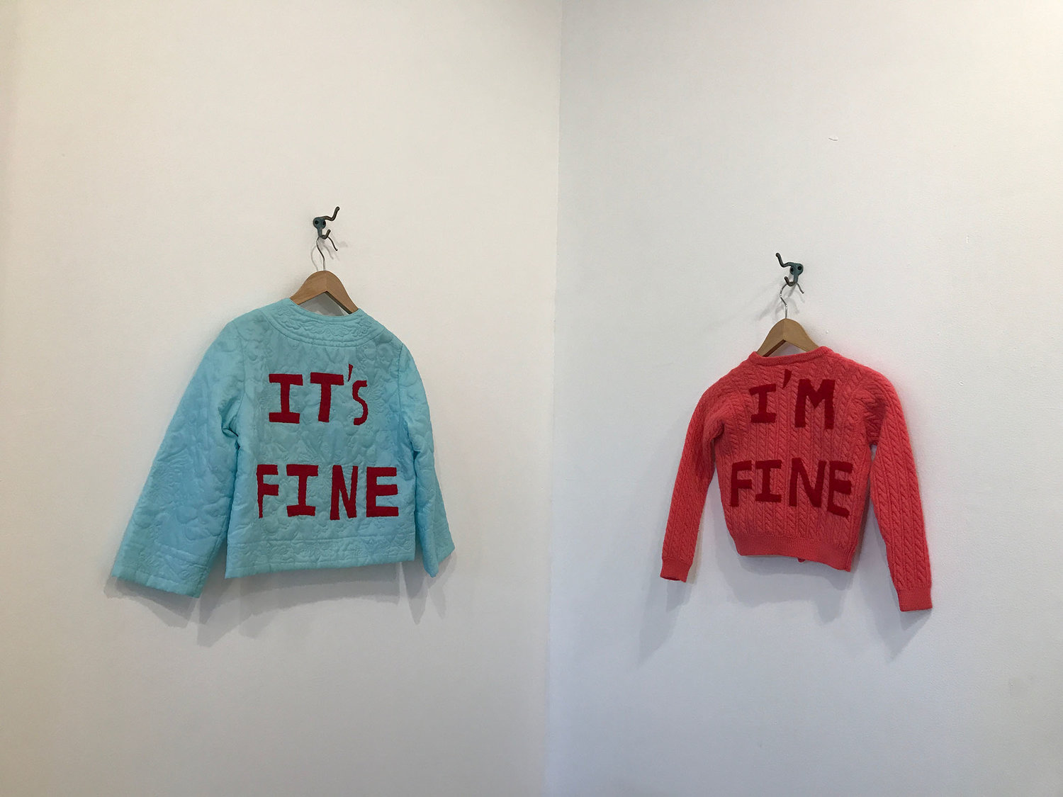 Carole Loeffler's sculptural exhibition features these vintage sweaters made from felt and thread.