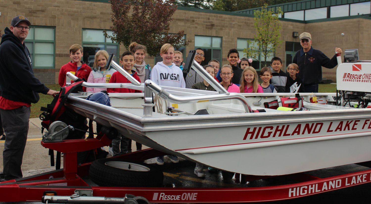 Members of the Highland Lake Fire Department and fourth graders reviewed boating safety tips and equipment used to perform water rescues during Fire Prevention Week.