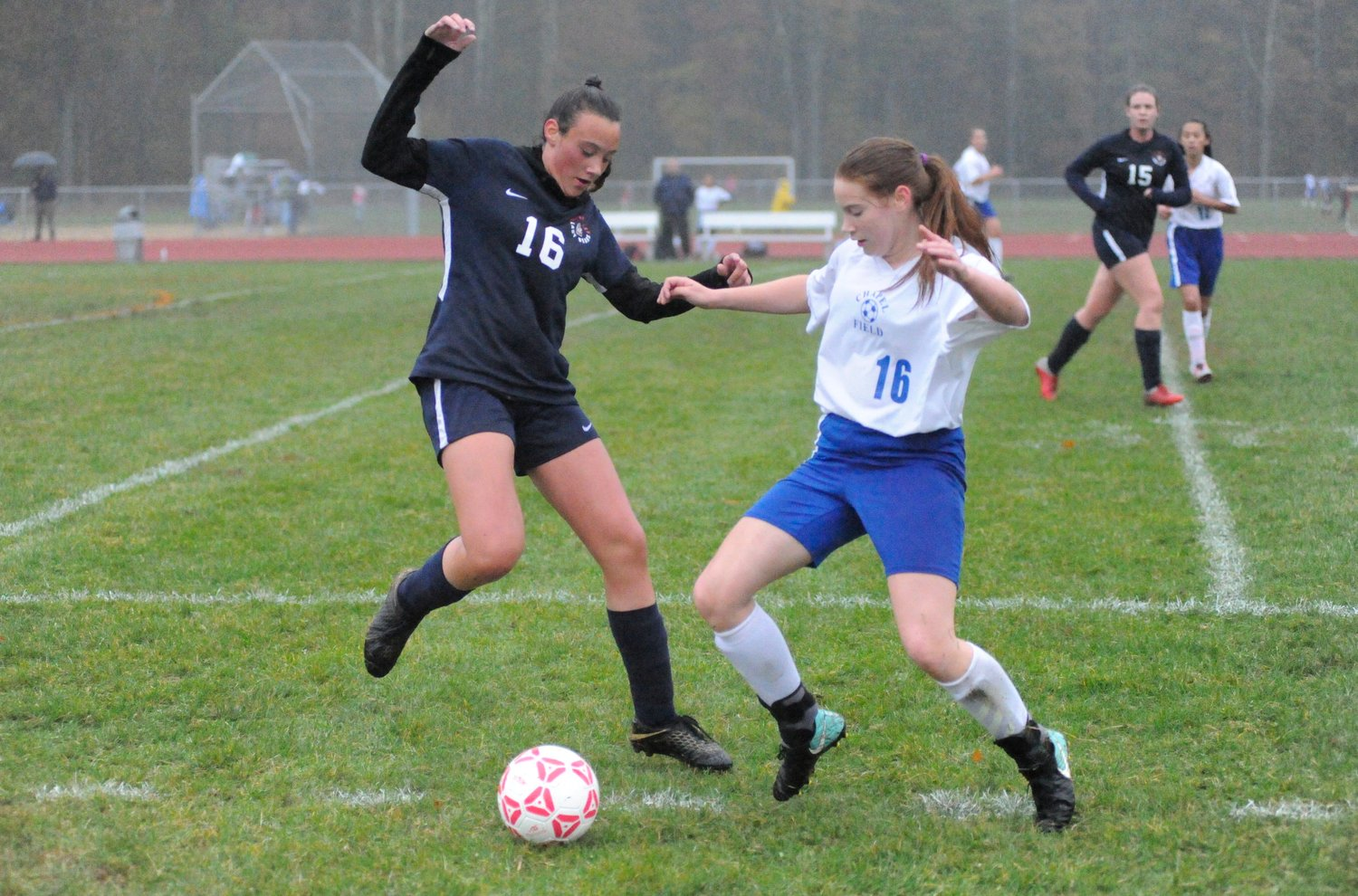 Fancy footwork. Tri-Valley's Juliana Kessler takes on Lillian Brooks of the Lady Lions.