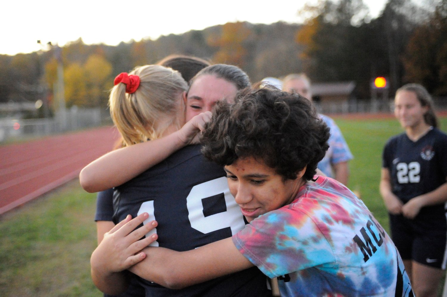 An emotional ending Tri-Valley's Samantha Houghtaling is surrounded by her teammates including Reanna McGregor at the conclusion on the homecoming ceremony.