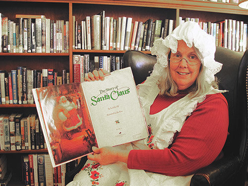 Mrs. Claus read to the kids during Bethany's Christmas in the Village at the Bethany Library in 2018