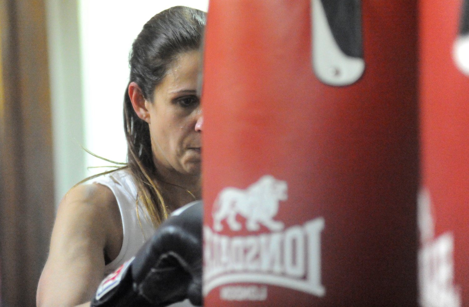 Attack mode. Megan Cheney gets up close and personal on the heavy bag.