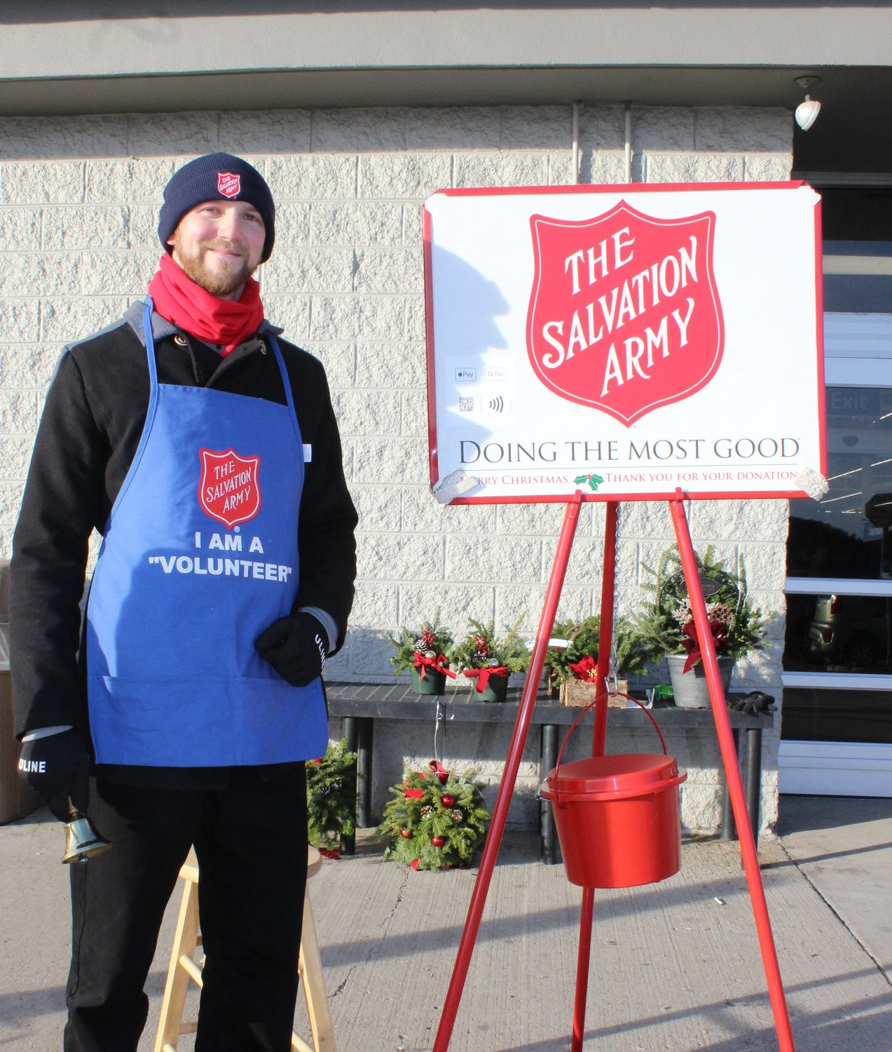 "Nicholas Georgi of Barrvyille, NY is stationed outside the Walmart in Honesdale as he bell rings for the Salvation Army. In his third year of ""standing kettle,"" Georgi got involved because he wanted to help people"